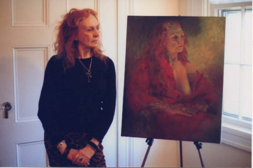 Mary Stanford standing beside a painting
