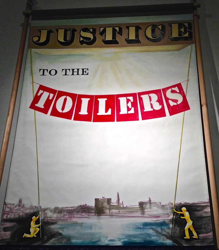 Newly painted banner by Ellen Babcock